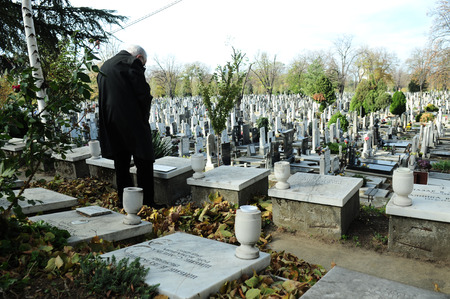 SERBIA, BELGRADE - NOVEMBER 11, 2012  Man paying tribute to fallen soldiers on Armistice Day