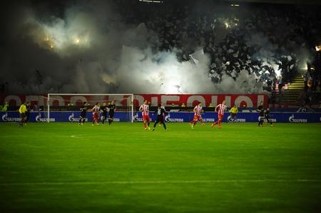 pyrotechnics: SERBIA, BELGRADE - APRIL 12, 2014: Soccer or football fans celebrating goal using pyrotechnics during Serbian championship soccer game between Red Star Belgrade and Cukaricki