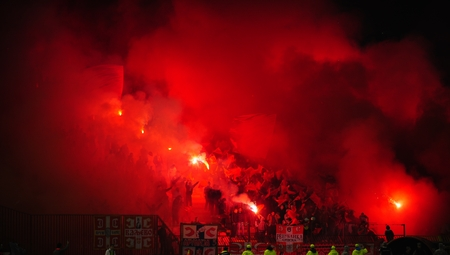 fanatics: SERBIA, BELGRADE - APRIL 12, 2014: Soccer or football fans celebrating goal using pyrotechnics during Serbian championship soccer game between Red Star Belgrade and Cukaricki