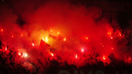 fierce competition: Soccer or football fans using pyrotechnics