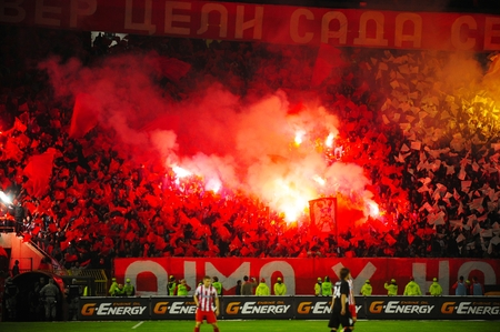 SERBIA, BELGRADE - APRIL 12, 2014: Soccer or football fans celebrating goal using pyrotechnics during Serbian championship soccer game between Red Star Belgrade and Cukaricki