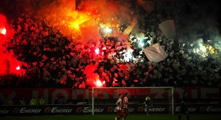 fanatics: SERBIA, BELGRADE - APRIL 12, 2014: Soccer or football fans celebrating goal using pyrotechnics during Serbian championship soccer game between Red Star Belgrade and Cukaricki