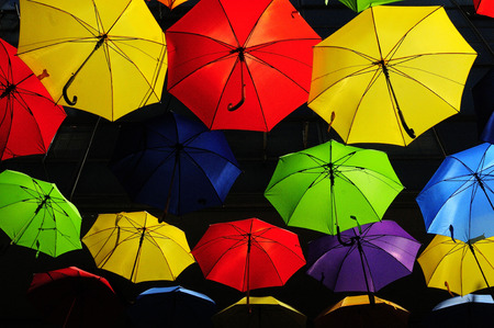 Sky decorated with colored umbrellas photo