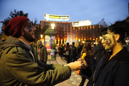 Belgrade, Serbia - October 26, 2014: People dressed as a zombie taking part in Zombie Parade on a streets of Belgrade during a zombie walk in Belgrade, The zombie walk is part of the events of upcoming Serbian film fiction festival