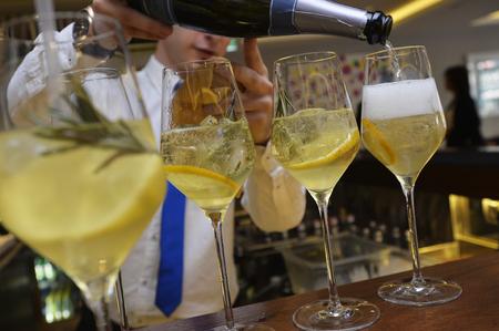 barmen: Barmen fills glasses of champagne cocktail