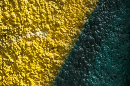 Colored textured wall with yellow and green, can be used as a background Standard-Bild - 129176505