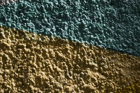 Colored textured wall with yellow and green, can be used as a background Standard-Bild - 129176506