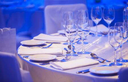 Luxury Table setting focus on the glass blue background 스톡 콘텐츠