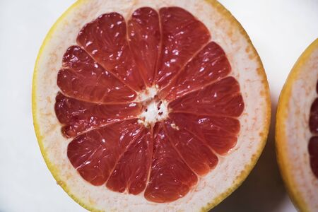 Grapefruit sliced half . Citrus fruit macro.Top view. Summer food concept. Stock fotó