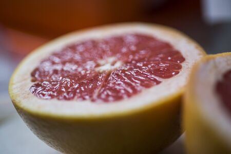 Grapefruit sliced half . Citrus fruit macro. Selective focus. Top view. Summer food concept.