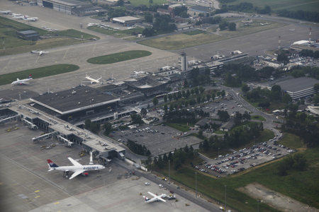 BELGRADE, SERBIA - 1 JUNE 2019: Airplane view of Nikola Tesla airport with airplanes at gates and parking spots in front Sajtókép