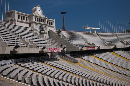 BARCELONA, SPAIN - SEPTEMBER 9, 2014: Olympic National Stadium Lewis Companys. Clock above empty tribunes on sport arena, built in 1927 and located in the Anella Olimpica Montjuic