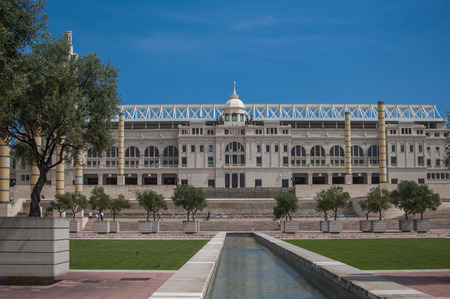 BARCELONA, SPAIN - SEPTEMBER 9, 2014: Exterior view of the Lluis Companys Olympic Stadium in Barcelona. It was renovated in 1989 to be the main stadium for the 1992 Summer Olympics