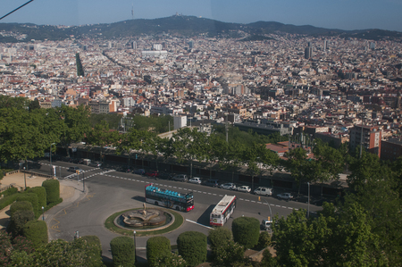 BARCELONA, SPAIN - 9 MAY 2019: Aerial view of Barcelona from the cableway to the Montjuic hill with the Barceloneta beach and Port Vell. Catalonia, Spain, Europe Publikacyjne