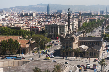 BARCELONA, SPAIN - 9 MAY 2015: Aerial view of Barcelona, Maritime Museum, from the cableway to the Montjuic hill with the Barceloneta beach and Port Vell. Catalonia, Spain, Europe Publikacyjne