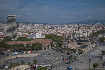 BARCELONA, SPAIN - SEPTEMBER 9, 2014: Aerial view of Barcelona, Maritime Museum, from the cableway to the Montjuic hill with the Barceloneta beach and Port Vell. Catalonia, Spain, Europe