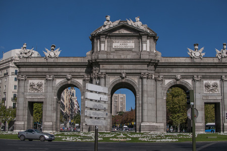 MADRID, SPAIN - SEPTEMBER 14, 2014: Puerta de Alcala is a Neo-classical monument in the Plaza de la Independencia in Madrid, Spain. It is regarded as the first modern post-Roman triumphal arch in Europe.