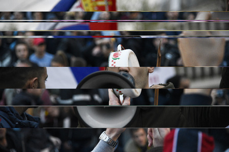 BELGRADE, SERBIA - APRIL 6, 2017: Young man with a megaphone during protest against the Serbian president in Belgrade Publikacyjne