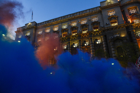 BELGRADE, SERBIA - 25 APRIL 2017: Demonstrators throw colored smoke in front of government building during protest after Aleksandar Vucic elected as a president of Serbia, in Belgrade Publikacyjne