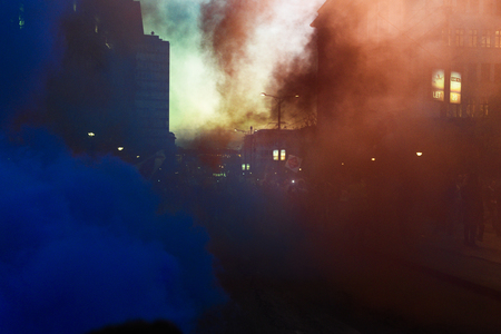 BELGRADE, SERBIA - 25 APRIL 2017: Demonstrators throw colored smoke during anti government protest ofter Aleksandar Vucic elected as a president of Serbia, in Belgrade