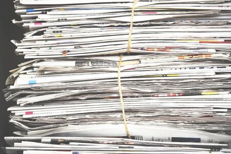 Pile of newspaper, background texture. Lots of retro journals with headlines, articles and photos