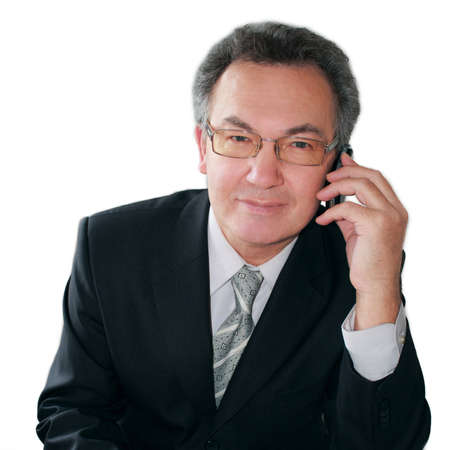 Portrait of successful businessman talking on handphone. Isolated on white.
