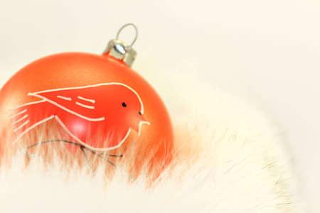 Orange Christmas Bauble on White Fur.