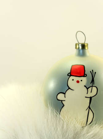 Christmas Bauble with Snowman on White Fur. Stock Photo