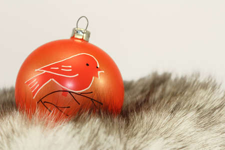 Orange Christmas Bauble on Fur.