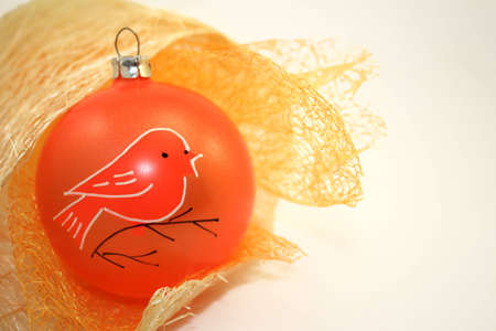 Orange Christmas Decoration over White Background.