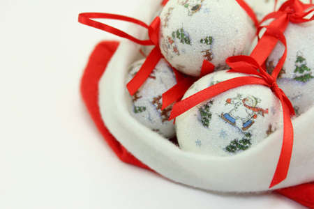 Christmas Baubles with Red Ribbonons in Santa Claus Hat.