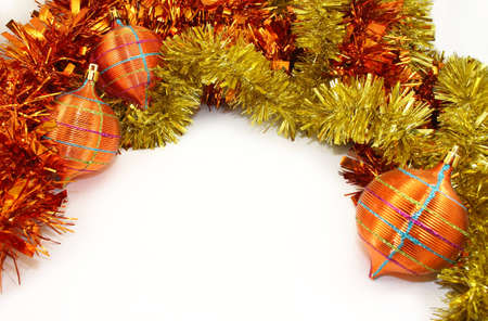 Orange-Yellow Christmas Decorations and Orange-Yellow Tinsel on White Background.