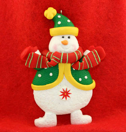 Christmas Snowman on Red Background.
