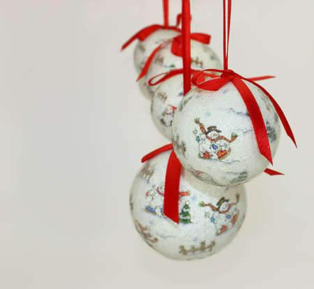Christmas Baubles with Red Ribbonons on White Background. Stock Photo