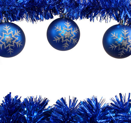 Snowflake Blue Christmas Decorations and Blue Tinsel on White Background. Stock Photo
