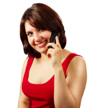 Pretty young smiling brunette talking on cell phone isolated on white background Stock Photo