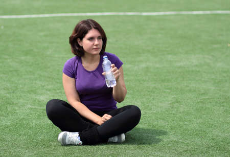 Beautiful Fitness Woman with Bottle of Water Stock Photo