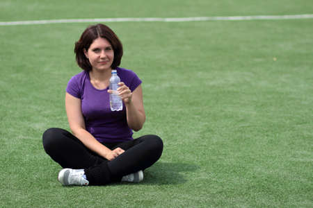 Beautiful Fitness Woman with Bottle of Water photo