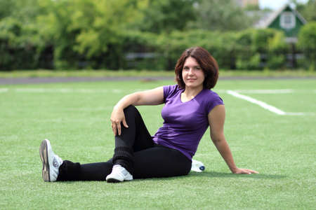 Beautiful Fitness Woman Sitting at Stadium