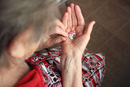 Drugs in old womans hands Stock Photo