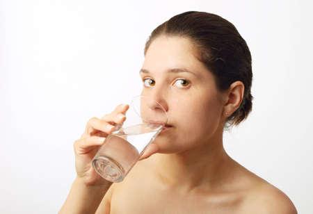 Young beautiful woman drinking water Stock Photo