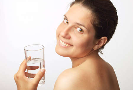 Young beautiful woman drinking water Stock Photo