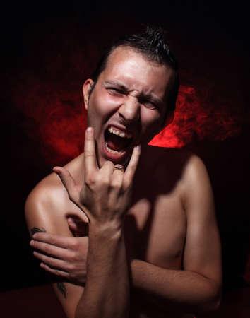 Stress concept. Aggressive young man