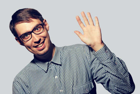 stereotypical: Funny young man wearing glasses say Hello Stock Photo