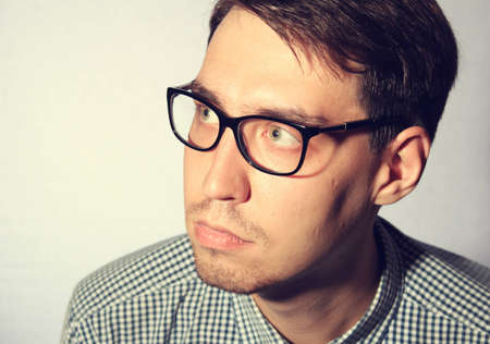 Funny young man wearing glasses