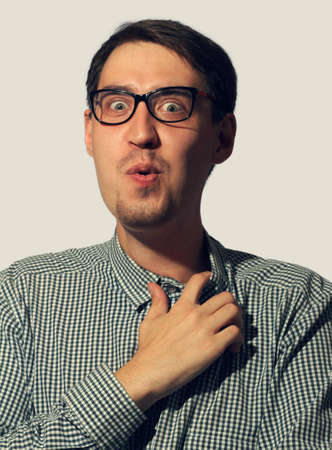 Surprised funny young man wearing glasses Stock Photo - 16086840