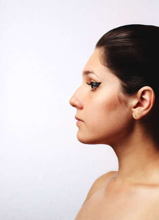 Young beautiful woman in profile with eye make-up Stock Photo