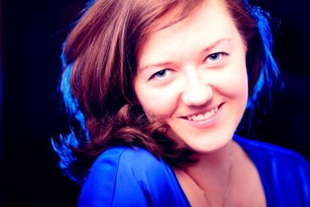 Portrait of beautiful brunette girl on dark background