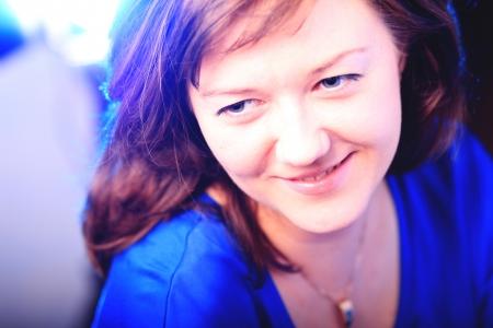Portrait of beautiful brunette girl on dark background photo