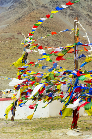 Tibetan flags with mantras develop in the wind. Scare away evil spirits. Stock fotó